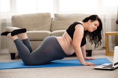 Obese woman working out with online personal couch. Fitness, online personal trainer, home training, technology and diet. overweight woman doing push-ups and stock photos