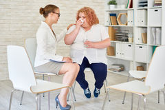 Obese Young Woman Crying in Meeting with Psychiatrist Royalty Free Stock Images