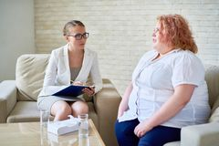 Obese Young Woman  Talking with Psychiatrist Stock Photos