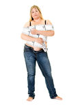 Obese young woman wrapped in tape measure Stock Photos