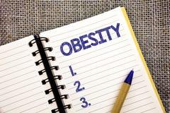 Obesidad del texto de la escritura de la palabra El concepto del negocio para el exceso de la dolencia de grasas de cuerpo acumul Fotografía de archivo