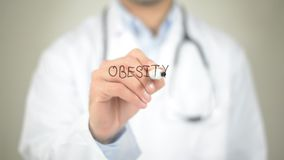 Obesidade, escrita do doutor na tela transparente imagem de stock