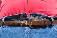 Obesità - ultimo foro della fascia Fotografia Stock Libera da Diritti