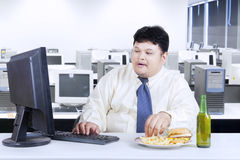Obesity businessman working in office Royalty Free Stock Images