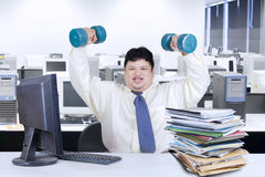 Obesity businessman working while workout 1 Stock Image
