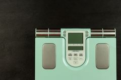 Obesity concept. Modern digital weight and legs. Weight control on diet.  stock photo