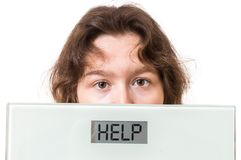 Free Obesity Concept. Overweight Woman Holds Scales With Help Written Stock Photo - 76563020