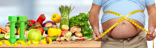 Obesity and healthy food. Stock Photography