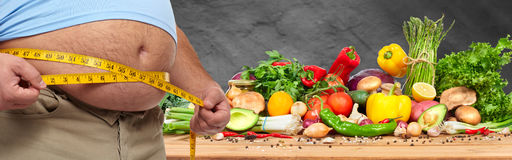 Obesity and healthy food. Stock Photos