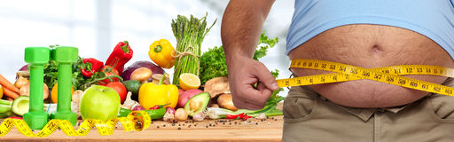 Obesity and healthy food. Royalty Free Stock Photos