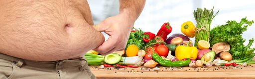 Obesity and healthy food Stock Image