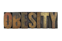 Obesity. Isolated on white and written in vintage letterpress type Royalty Free Stock Photography