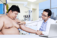 Obesity person visits doctor to checkup Royalty Free Stock Photos