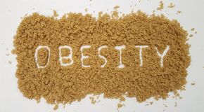 Obesity Spelled Out in Brown Sugar on White Background stock photography