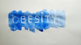 Obesity text inscription watercolor artist paints blot isolated on white background art. Obesity text inscription watercolor artist paints blot isolated on white stock video footage