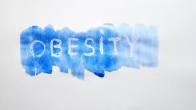 Obesity text inscription watercolor artist paints blot isolated on white background art. Obesity text inscription watercolor artist paints blot isolated on white stock photo