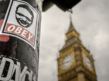 Obey and Big Ben Tourist Attraction. Famous London Tourist attraction Big Ben and Obey sticker royalty free stock photography