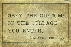 Obey customs JP. Obey the customs of the village you enter - ancient Japanese proverb printed on grunge vintage cardboard Stock Photo