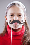 Obey to my moustaches, people!. Little girl with fake mustache laying down the law being stuck up stock photo
