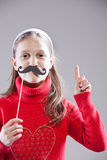 Obey to my moustaches, people!. Little girl with fake mustache laying down the law being stuck up royalty free stock image
