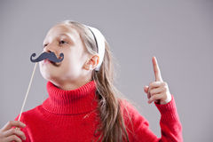 Obey to my moustaches, people!. Little girl with fake mustache laying down the law being stuck up royalty free stock images