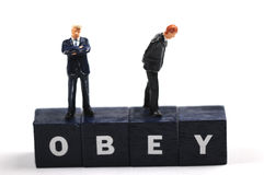 Obey your boss stock photo