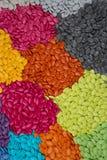 Obfitość cukierków dragees, kolorowa czekolada na tle Obrazy Royalty Free