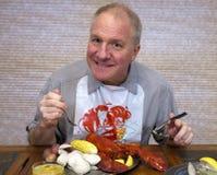 obiadowy łasowania homara mężczyzna Obrazy Royalty Free