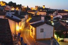 Obidos lights at dusk. Walled town of Obidos at dusk . Portugal Royalty Free Stock Photography