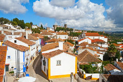 Obidos. Narrow cobbled streets and traditionally painted houses in Obidos, Portugal Stock Photos