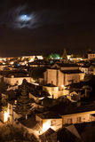 Obidos by night. Night scene with long exposure of medieval obidos light by moon. Blurred clouds Stock Photography