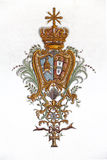 Obidos, Portugal.  Baroque fresco of the Portuguese Royal Coat of Arms with Vatican emblem in Sao Pedro Church Stock Images