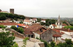 Beautiful tiny cobblestoned streets, walls, and roofs in Obidos royalty free stock photos