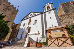 Obidos, Portugal. Santiago Church and Albarra Castle Tower Stock Photography