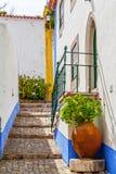 Obidos, Portugal Typische middeleeuwse straat Royalty-vrije Stock Afbeelding