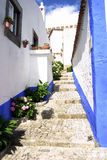 Obidos slope. Step street with homes of obidos city, Portugal Stock Photography