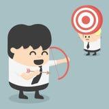 Obiettivo della fucilazione dell'uomo d'affari con un arco ENV 10 Fotografia Stock