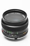 Obiettivo della macchina fotografica DSLR dell'annata su bianco Fotografia Stock