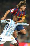 Obinna of Malaga and Puyol of Barcelona Stock Photography