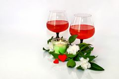 Wine, flowers and a small heart. Still-life with two hearts, wine and flowers Royalty Free Stock Image