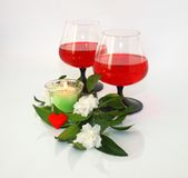 Wine, flowers and a small heart. Still-life with wine, flowers and a small heart Royalty Free Stock Image