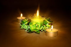 Candles and flowers. Still-life with candles Stock Photos