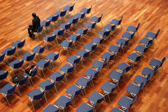 Object. Last man waiting with rows of empty chair behind him Stock Images