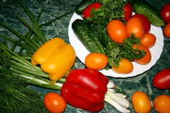 Vegetables and greens. Still-life with vegetables and greens Royalty Free Stock Photos