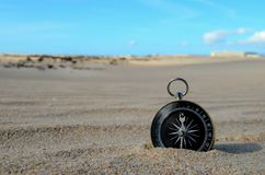 Object in the Dry Desert. Conceptual Photo Picture of a compass in the dry desert royalty free stock photos