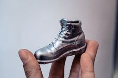 Free Object In The Form Of A Boot Printed On A 3d Printer And Covered With Enamel Stock Images - 115457654
