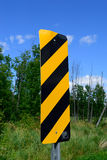 Object Marker Sign on Rural Road. Sign warning of bridge ahead royalty free stock photos