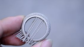Object printed in laser sintering machine. Man is holding object printed on metal 3d printer. Object printed in laser sintering machine. Modern 3D printer stock footage