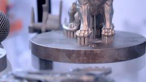 Modern 3D printer printing from metal powder. Object printed on metal 3d printer close-up. Object printed in laser sintering machine. Modern 3D printer printing stock video footage