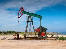 Object in situ color photo. Oil well pump on the beach, Havana, Cuba Stock Images
